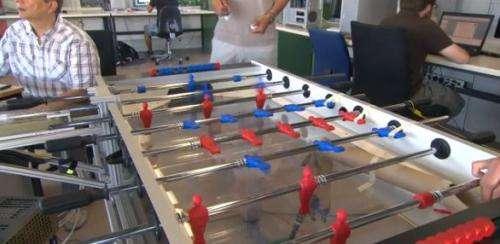 A robot to beat humans at foosball