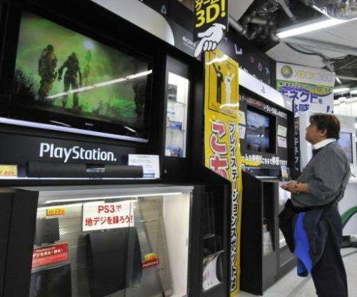 File photo shows a customer watching a monitor of Sony's videogame PlayStation 3, in Tokyo, on April 27, 2011