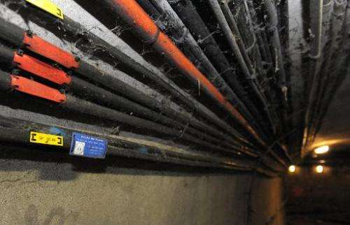 File photo taken on December 18 2012 shows fibre-optic internet cables in the sewers of Paris