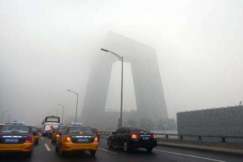 Heavy smog shrouds Beijing, on June 5, 2013, with much believed to be due to coal consumption