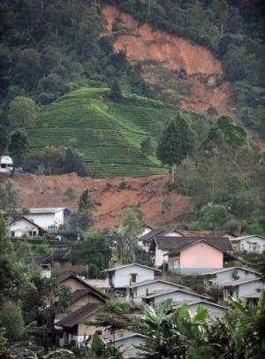 Houses in Dewata village, West Java lie buried under earth after a landslide in February 24, 2010