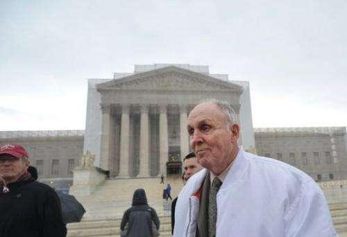 Indiana grain farmer Vernon Hugh Bowman walks past the US Supreme Court on February 19, 2013 in Washington