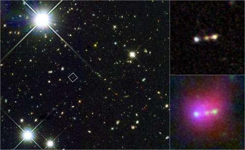 Infant galaxies merging near 'cosmic dawn'