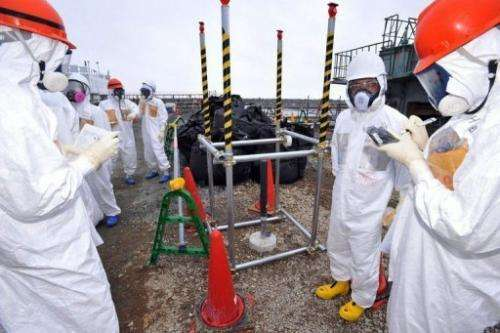 Japanese officials inspect a monitoring well at the Fukushima Dai-ichi nuclear plant in Okuma, on August 6, 2013
