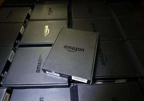 Kindle electronic readers are stacked at Amazon's San Bernardino Fulfillment Center October 29, 2013 in California