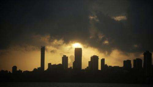 Monsoon clouds hover over the Mumbai skyline on September 7, 2012