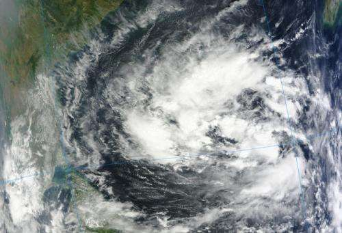 NASA sees ex-Tropical Depression 30W trying to re-form in Indian Ocean