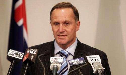 New Zealand's Prime Minister John Key speaks to the media in Wellington on October 27, 2010