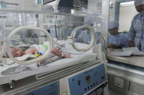 One of baby twin girls borned to a sixty-year-old Chinese woman who received in vitro fertilisation on May 25, 2010