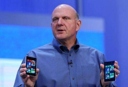 Outgoing Microsoft CEO Steve Ballmer, pictured in June holding Windows phones