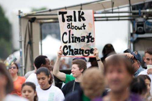 People advocate for more attention for climate change at a rally on the National Mall on April 25, 2010 in Washington