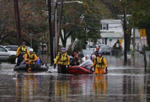 People are evacuated from a neighborhood in Little Ferry, New Jersey on October 30, 2013