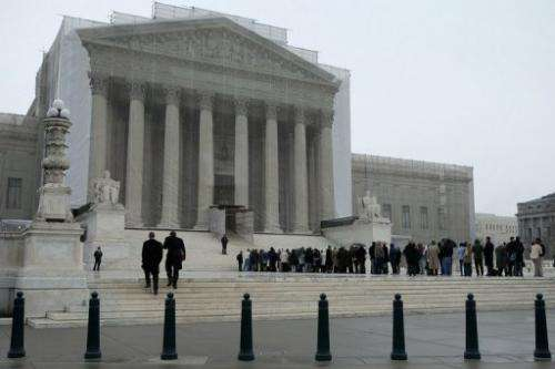 People stand outside U.S. Supreme Court on March 18, 2013 in Washington, DC