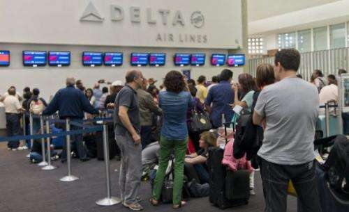 People wait for their flights at Mexico City's airport on July 5, 2013