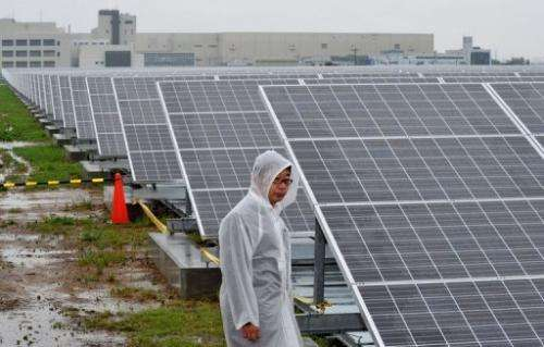 Solar power panels are seen outside a plant in Kyoto, Japan on July 1, 2012