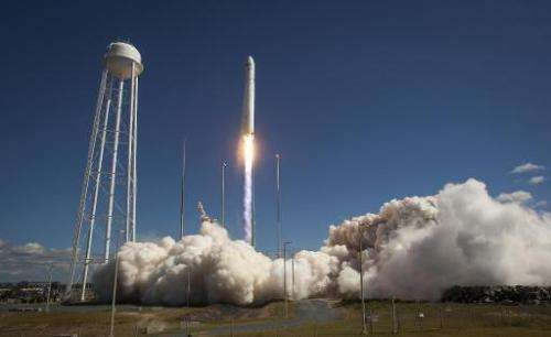 This photo courtesy of NASA shows the Orbital Sciences Corporation Antares rocket, with the Cygnus cargo spacecraft aboard, as i