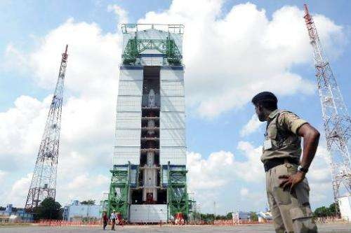 This photograph taken on October 30, 2013 shows an Indian security forces member keeping watch near the PSLV-C25 launch vehicle,