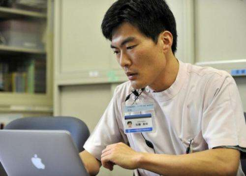 This photo taken on June 25, 2012 shows Hideaki Kato speaking during an interview with AFP at his office in Yokohama
