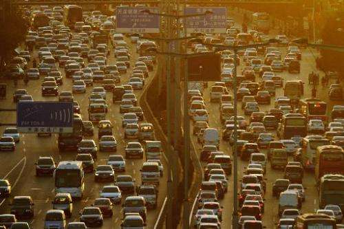 Traffic moves during rush-hour in Tianjin, China on October 10, 2013