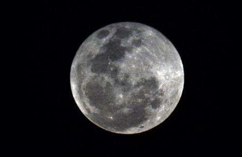 View of a full moon in Panama City on April 25, 2013