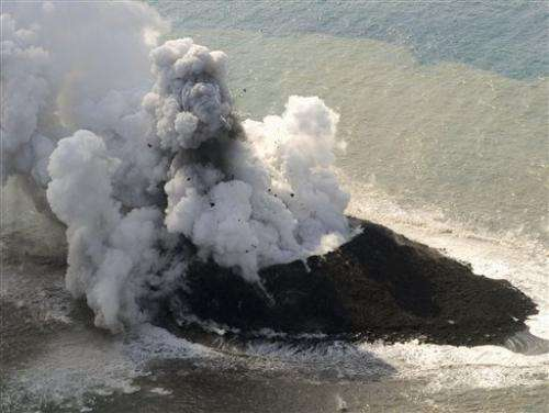 Volcano raises new island far south of Japan