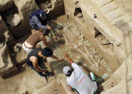 Workers uncover a burial chamber in the Cao religious compound, near the city of Trujillo, Peru, on August 3, 2013