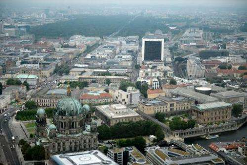 An aerial view taken on May 29, 2012 shows the protestant church Berliner Dom (Berlin Cathedral) (L) on the Unter den Linden ave
