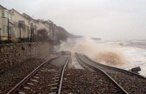 A Network Rail picture shows waves whipped up by stormy weather crashing over train lines in Dawlish in south Devon, southern En