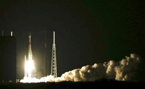 Atlas V rocket launches, taking satellite aloft