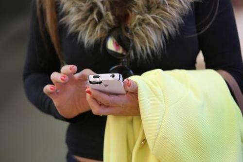 A woman uses an Iphone on April 22, 2014 in New York