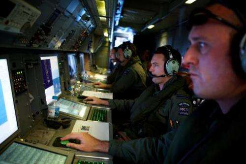 Crew members of a Royal New Zealand Air Force P-3 Orion during a search for Malaysia Airways Flight MH370 over the southern Indi
