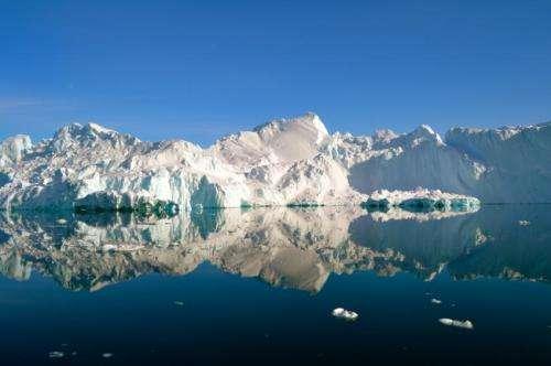Evolving plumbing system beneath Greenland slows ice sheet as summer progresses