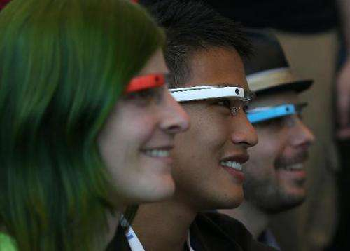 File picture shows attendees wearing Google Glass while posing for a group photo during the Google I/O developer conference on M