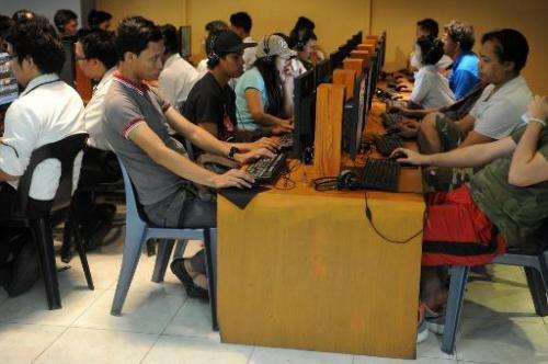 Filipino youths gather at an Internet cafe in Manila on February 18, 2014