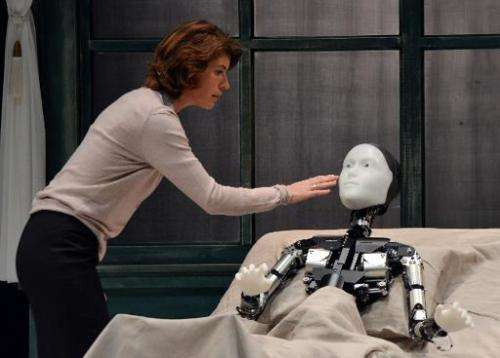 """French actress Irene Jacob performs with android Repliee S1 during a dress rehearsal of """"La Metamorphose version Androide&q"""
