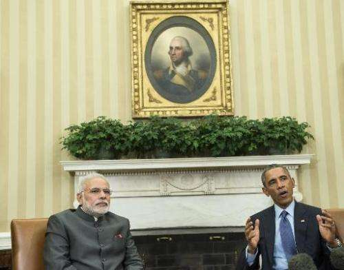 Indian Prime Minister Narendra Modi (L) listens while US President Barack Obama makes a statement to the press after a meeting i