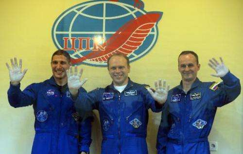 (L-R) US astronaut Michael Hopkins and Russian cosmonauts Oleg Kotov and Sergei Ryazansky at a press conference at the Baikonur