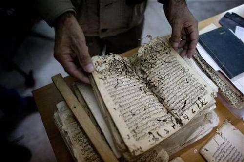 Old manuscripts get face-lift at Jerusalem mosque