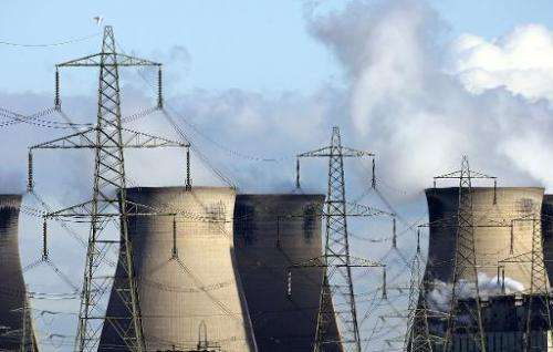 Steam rises from cooling towers at a coal power plant near Leeds, in north England, on October 30, 2006