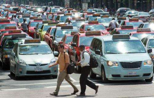 Taxi drivers park on Pennsylvania Avenue in protest against ride sharing services such as Uber X and Lyft on June 25, 2014, in W