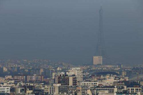 The Eiffel Tower is seen through a haze of pollution, in Paris, on December 12, 2013