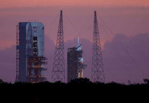 The United Launch Alliance Delta 4 rocket carrying NASA's first Orion deep space exploration craft is seen on its launch pad on