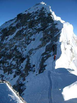 Unidentified mountaineers pass the Hillary Step while pushing for the summit of Mount Everest from Nepal in 2013