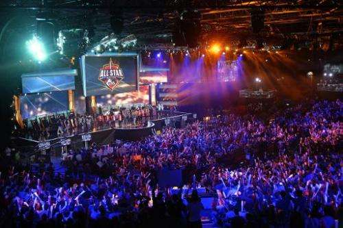 """Visitors cheer for international teams during the tournament of the computer game """"League of Legends"""" on May 8, 2014 i"""