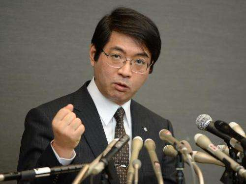Yoshiki Sasai, supervisor of Haruko Obokata, a scientist at Riken institute, answers questions during a press conference in Toky