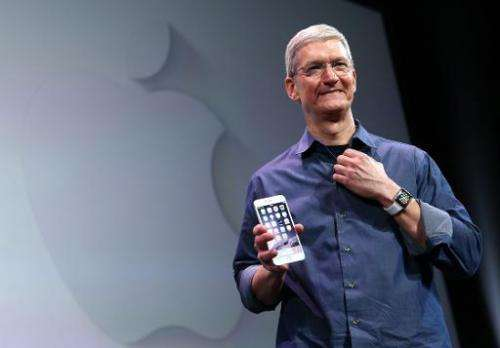 Apple CEO Tim Cook shows off the new iPhone 6 and the Apple Watch at the Flint Center for the Performing Arts in Cupertino, Cali