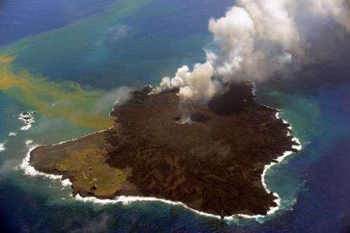 Picture taken by Japan Coast Guard on July 23, 2014 shows a newly created islet (R) and Nishinoshima island (L), which are conjo