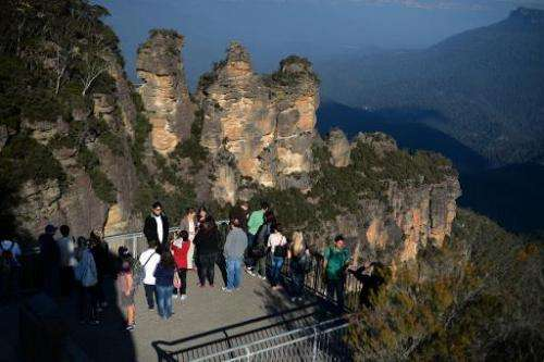 File photo shows visitors looking at the 'Three Sisters' rock formation in the Blue Mountains, in New South Wales, Australia