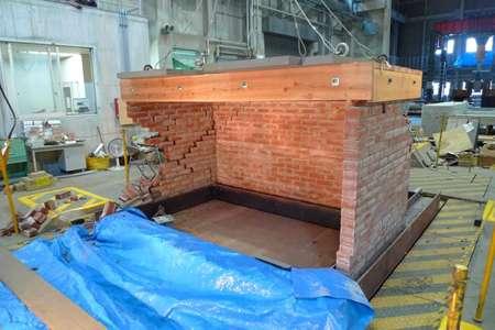Experimental study on dynamic behavior of unreinforced masonry walls