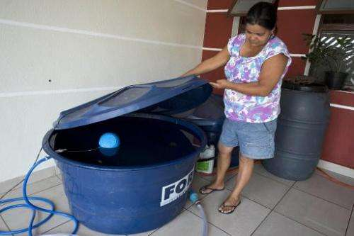 A local resident checks water tank in Itu, some 103 km of Sao Paulo, on November 19, 2014, as the nine-month rationing of water